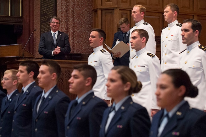 Defense Secretary Ash Carter applauds newly commissioned officers after administering the oath of office to Air Force and Naval Reserve Officers' Training Corps students during a commissioning ceremony at Yale University in New Haven, Conn., May 23, 2016. DoD photo by Air Force Senior Master Sgt. Adrian Cadiz