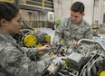 Senior Airmen Natalie Beal and Ryan Nalepa, 919th Special Operations Maintenance Group, perform maintenance on an aircraft engine at Duke Field Fla., Feb. 25.  The Airmen are part of the engine shop within the maintenance group.  (U.S. Air Force photo/Tech. Sgt. Sam King)