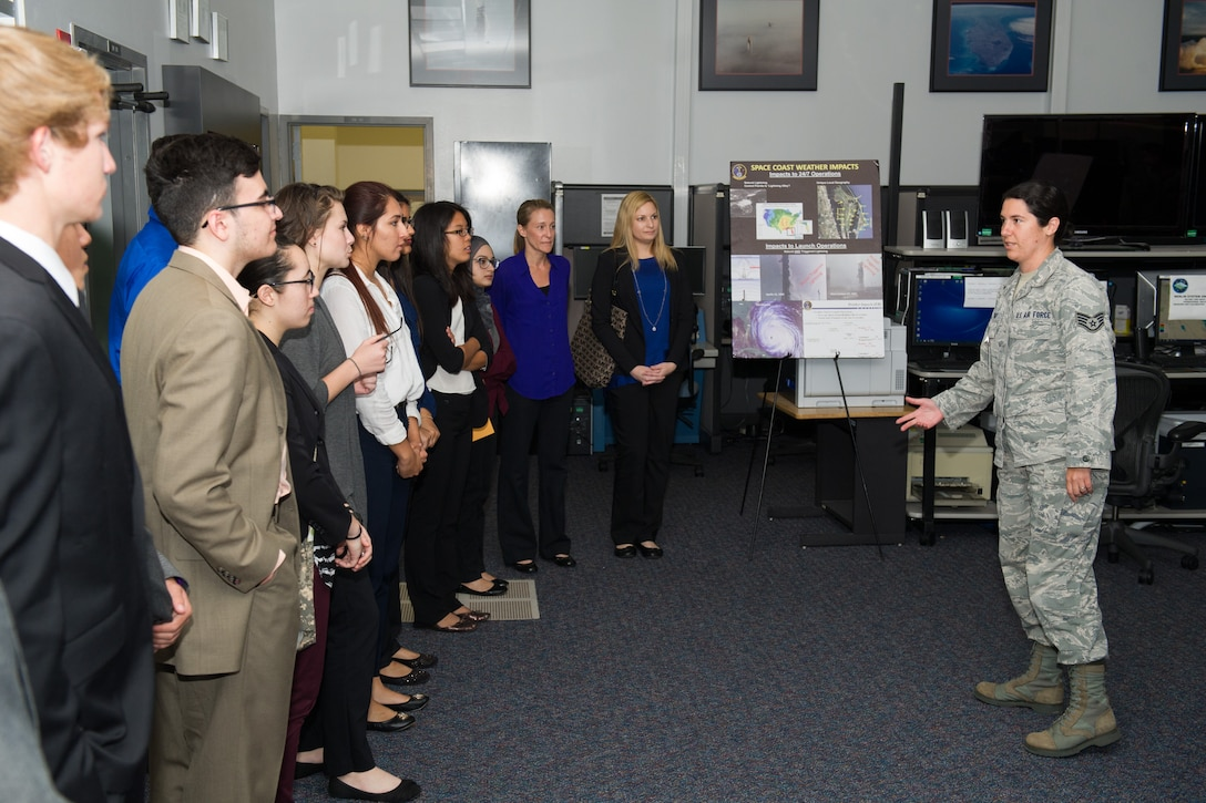 Members of the 45th Space Wing Weather Squadron met with Lake Nona High School students at Cape Canaveral Air Force Station, Fla. May 23, 2016, to discuss their Lightning Launch Commit Criteria (LLCC) findings and results in regards to weather and climatology. Prior to the school year, Bill Roeder, 45th Space Wing Weather Squadron meteorologist, reached out to the high school and introduced them to the project. The project provides students with real-world experience by following a business model of preparation, set-up, and using innovative methods to complete it. During the visit, the students also met with leadership and toured the Morrell Operations Center. (U.S. Air Force photos/Benjamin Thacker/Released)