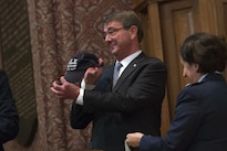 Defense Secretary Ash Carter shows off a Yale Air Force ROTC hat that was presented to him after he delivered remarks at a commissioning ceremony at Yale University in New Haven, Conn., May 23, 2016. DoD photo by Air Force Senior Master Sgt. Adrian Cadiz