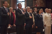 Defense Secretary Ash Carter, second from left, and Yale University President Peter Salovey render honors during the playing of the national anthem before the ROTC commissioning ceremony at Yale University in New Haven, Conn., May 23, 2016. DoD photo by Air Force Senior Master Sgt. Adrian Cadiz