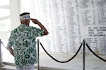 Sterling R. Cale, treasurer, Pearl Harbor Survivors Association Unit 1, salutes his fallen comrades in the rear of the USS Arizona Memorial Monday during the Memorial Ceremony and Interment of James Evans Cory, the first Marine to be buried aboard the Arizona since World War II.