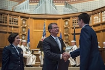 Defense Secretary Ash Carter congratulates a newly commissioned Air Force second lieutenant after administering the oath of office to Air Force and Navy ROTC students during a commissioning ceremony at Yale University in New Haven, Conn., May 23, 2016. DoD photo by Air Force Senior Master Sgt. Adrian Cadiz