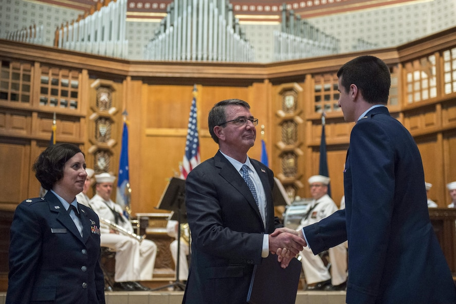 Photo of Defense Secretary Ash Carter congratulating a newly commissioned Air Force second lieutenant.