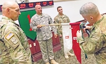 Maj. Gen. Wayne W. Grigsby Jr., far right, 1st Infantry Division and Fort Riley commanding general, and Command Sgt. Maj. Joseph Cornelison, far left, the division's senior noncommissioned officer, attach a streamer to the guidon of Troop D, 1st Squadron, 6th Cavalry Regiment, 1st Combat Aviation Brigade, 1st Inf. Div., for the 2nd quarter best company, troop or battery competition as 1st Sgt. Vincent Farrell and Capt. Wesley Cogdal, command team for Troop D, present the troop guidon.  The quarterly competition is an administrative competition that tallies cumulative scores across companies in the division and Fort Riley in areas ranging from the Army physical fitness test to weapons qualifications and includes scores for areas such as medical readiness and other administrative milestones.