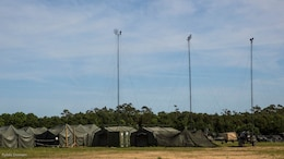 Tents, communication networks and vehicles are set up for Marines to operate during MEFEX 16 at Marine Corps Base Camp Lejeune, N.C., May 16, 2016. MEFEX 16 is a command and control exercise conducted in a simulated deployed environment designed to synchronize and bring to bear the full spectrum of II Marine Expeditionary Force's C2 capabilities in support of a Marine Air-Ground Task Force. Conducting exercises of this nature ensures II MEF remains ready to provide the Marine Corps with an experienced staff capable of integrating with international allies and partner nations in a combined joint task force, charged with accomplishing a wide range of military operations.