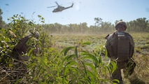A UH-1Y Venom helicopter hovers above a landing zone outside of Robertson Barracks, Northern Territory, Australia, on May 20, 2016. Marines with Marine Rotational Force - Darwin simulated causality evacuations with a UH-1Y Venom helicopter. MRF-D is a six-month deployment of Marines into Darwin, Australia, training in a new environment.