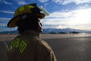 PETERSON AIR FORCE BASE, Colo. – Airman 1st Class Fred Lokan, a 21st Civil Engineer Squadron firefighter, stands on the flightline at Peterson Air Force Base, Colo., on May 21, 2016. Even though the mountains are bigger than the those in American Samoa, Lokan says they still remind him of life back on the island. (U.S. Air Force photo by Airman 1st Class Dennis Hoffman)