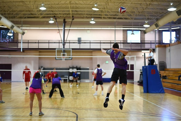 PETERSON AIR FORCE BASE, Colo. – The 21st Space Wing Staff Agency intramural volleyball team serves the volleyball to the NORAD/U.S. Northern Command intramural volleyball team in the Peterson Fitness Center on May 18, 2016. The WSA team won three consecutive games to win the match. (U.S. Air Force photo by Airman 1st Class Dennis Hoffman)