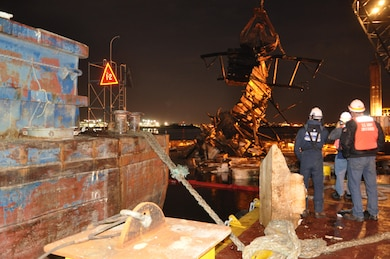 The U.S. Army Corps of Engineers, New York District, and U.S. Navy Supervisor of Salvage, personnel observe over night crane operations to remove derelict barges from Flushing Bay, in Queens, N.Y.