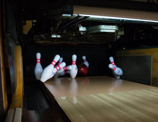 Bowling pins get knocked down during the Armed Forces Bowling Championships at Travis Air Force Base, California (U.S. Air Foce Photo by Louis Briscese)