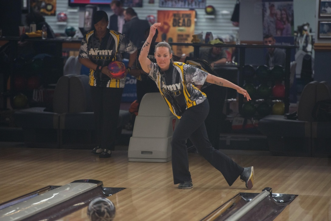 U.S Army Staff Sergeant Rose Brown, a military police officer assigned to Fort Bliss, Texas, warms up before competing in the Armed Forces Bowling Championship, Travis Air Force Base, Calif. The week long event showcases the Services best bowlers who compete for best male, female and team bowlers, May 11, 2016. (U.S. Air Force Photo by Louis Briscese/Released)