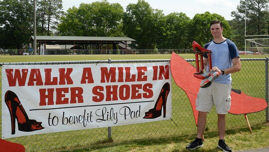 Petty Officer 3rd Class Bryce Barfield, Naval Branch Health Clinic-Albany, finished first place in the Walk a Mile in Her Shoes event benefitting Lily Pad at Deerfield-Windsor School's Webb Memorial Stadium in Albany, Ga., recently.