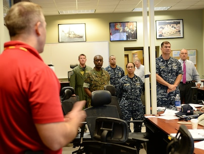Steve Dancer, emergency manager, Marine Corps Logistics Base Albany, briefs Col. James C. Carroll III, commanding officer, MCLB Albany, during Hurricane Exercise 16 aboard the installation, May 17.