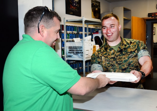 Staff Sgt. Steven McGahee, postal clerk, Marine Corps Logistics Base Albany, assists a customer at the installation's mailroom, May 12. McGahee was meritoriously promoted to his current rank recently after winning the final meritorious promotion board at Marine Corps Installations Command.