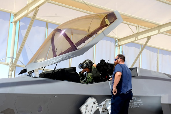 Lt. Col. Gregory Frana, 62nd Fighter Squadron commander, prepares to remove his helmet May 19, 2016, at Luke Air Force Base after flying Luke's 5000th F-35 sortie. Paul Linski, 62nd Aircraft Maintenance Unit Lockheed Martin crew chief, stands by to assist Frana in safely removing his gear and exiting the jet. (U.S. Air Force photo by Airman 1st Class Pedro Mota)