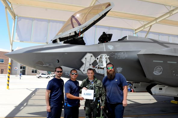 Lt. Col. Gregory Frana, 62nd Fighter Squadron commander, celebrates May 19, 2016, at Luke Air Force Base after flying Luke's 5000th F-35 sortie. (U.S. Air Force photo by Airman 1st Class Pedro Mota)