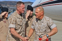 CAMP PENDLETON, Calif. -- General Robert Neller, Commandant, United States Marine Corps, shakes hands with Brig. Gen. Edward Banta, Commanding General, Marine Corps Installations - West, during a tour of Marine Corps Air Station Camp Pendleton, May 24.