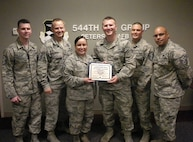 Senior Airman Nicholas Cavanaugh, 544th Intelligence, Surveillance and Reconnaissance Group command support staff, receives the Diamond Sharp Award from the 21st Space Wing First Sergeant Council at Peterson Air Force Base, Colo. on May 18, 2016. Cavanaugh was responsible for roll out of the new Air Force evaluation system at the 544th ISRG for more than 527 personnel. Additionally, he is the founder of a non-profit organization advocating for sex trafficking victims in Colorado and transformed the lives of 20 women by raising $120,000 to assist in rehabilitation. (U.S. Air Force photo)