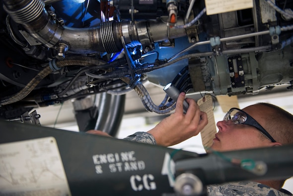 U.S. Air Force Tech. Sgt. Matthew Cohen, 23d Maintenance Group quality assurance inspector, scans the components of a TF-34 jet engine during an inspection, May 24, 2016, at Moody Air Force Base, Ga. QA inspectors ensure that aviation assets conform to established requirements throughout their life cycle for maximum serviceability. (U.S. Air Force photo by Airman 1st Class Greg Nash/Released)