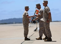 Maj. Gen. Michael Rocco, commanding officer of 3rd Marine Aircraft Wing, hands a noncommissioned officer sword to Master Chief Petty Officer Gary Mendus, the incoming command master chief of the 3rd MAW, during a change of command ceremony aboard Marine Corps Air Station Miramar, Calif., May 23. During the ceremony, Mendus relieved Master Chief Petty Officer Frank Dominguez from his post after a four-year tour with the wing. Marines and Sailors of 3rd MAW participated in the ceremony, along with a performance from the 3rd MAW Band. (U.S. Marine Corps photo by Cpl. Kimberlyn Adams/Released)