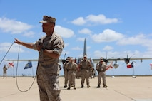 Maj. Gen. Michael Rocco, the commanding general of the 3rd Marine Aircraft Wing, gives a speech during a post and relief ceremony aboard Marine Corps Air Station Miramar, Calif., May 23. During the ceremony, Master Chief Petty Officer Frank Dominguez, outgoing command master chief of the 3rd Marine Aircraft Wing, relinquished his post to Master Chief Petty Officer Gary Mendus. Marines and Sailors of 3rd MAW participated in the ceremony, along with a performance from the 3rd MAW Band. (U.S. Marine Corps photo by Cpl. Kimberlyn Adams/Released)