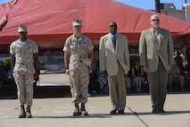 Sgt. Maj. James Porterfield, sergeant major of 3rd Marine Aircraft Wing, Sgt. Maj. Patrick Kimble and two former 3rd MAW sergeants major stand at attention for pass in review during a post and relief ceremony aboard Marine Corps Air Station Miramar, Calif., May 23. During the ceremony, Kimble relinquished his post to Porterfield. Marines and Sailors of 3rd MAW participated in the ceremony, along with a performance from the 3rd MAW Band. (U.S. Marine Corps photo by Cpl. Kimberlyn Adams/Released)
