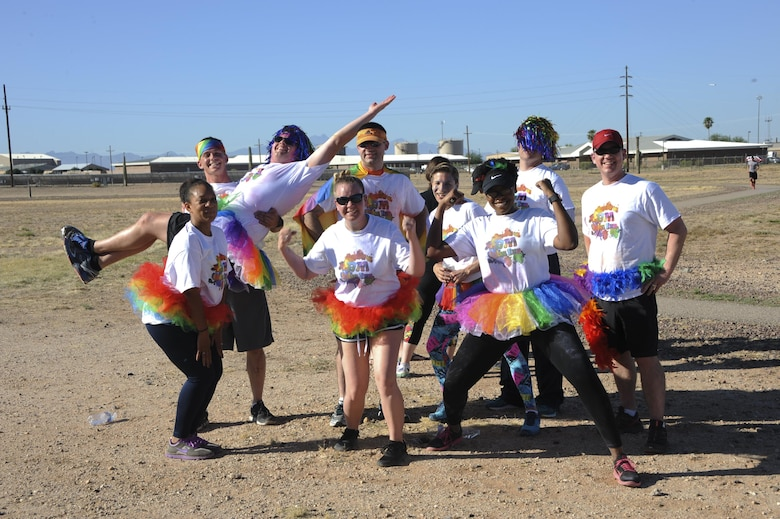 Participants of the Cultural Awareness Color Run pose for a group photo at Davis-Monthan Air Force Base, Ariz., May 20, 2016. There were more than 90 participants and about 30 volunteers at the run. (U.S. Air Force photo by Airman Nathan H. Barbour/Released)