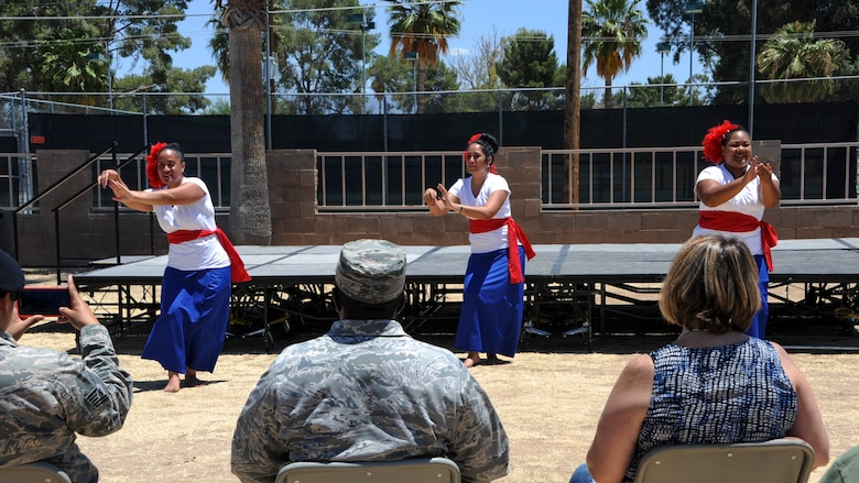 The Samoan dance group performs in front of U.S. Airmen and civilians during the Cultural Awareness Festival Breaking Through Barriers: Past, Present and Future at Davis-Monthan Air Force Base, Ariz., May, 2016. The festival was held as an alternate to the Department of Defense supported observances by combining all observances into one event. (U.S. Air Force photo by Airman Nathan H. Barbour/Released)