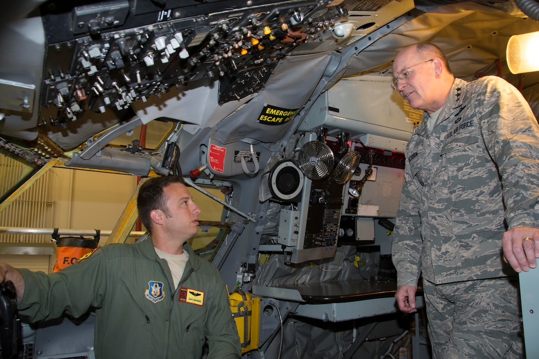 """Capt. Dan Shaheen, 465th Air Refueling Squadron pilot, briefs KC-135 Block 45 capabilities to Lt. Gen. James """"JJ"""" Jackson, Chief of Air Force Reserve and Commander, Air Force Reserve Command, May 14, 2016, at Tinker Air Force Base, Oklahoma. Jackson visited Citizen Airmen in the 507th Air Refueling Wing and 513th Air Control Group during their May Unit Training Assembly. (U.S. Air Force Photo/Maj. Jon Quinlan)"""