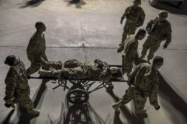 "Air Force and Army teams conduct a mass casualty exercise at Bagram Airfield, Afghanistan, May 21, 2016. The airmen are assigned to the 455th Expeditionary Medical Operations Squadron and the soldiers are assigned to the ""Dustoff"" Medical Evacuation Unit. The exercises prepare first responders to react to an accident or emergency. Air Force photo by Senior Airman Justyn M. Freeman"
