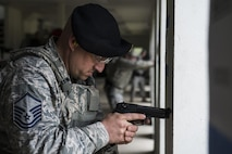 U.S. Air Force Master Sgt. Jeramy Lemons, the 213th Security Force Squadron training manager at Clear Air Force Station, waits for the start of a small arms competition at Eielson Air Force Base, Alaska, May 17, 2016, as part of National Police Week activities. The small arms competition was one of the main events for the week, along with equipment displays, a military working dog competition and the Fallen Heroes 5K Run/Ruck. (U.S. Air Force photo by Staff Sgt. Joshua Turner/Released)