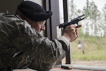 U.S. Air Force Master Sgt. Jeramy Lemons, the 213th Security Force Squadron training manager at Clear Air Force Station, fires an M9 pistol during a small arms competition at Eielson Air Force Base, Alaska, May 17, 2016, as part of National Police Week activities. Police week is a time set aside to remember those who have fallen defending others and learn how law enforcement and security forces members contribute to public safety on a daily basis. (U.S. Air Force photo by Staff Sgt. Joshua Turner/Released)