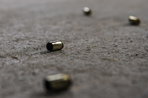 Empty 9mm rounds lie scattered on the ground during a small arms competition at Eielson Air Force Base, Alaska, May 17, 2016, as part of National Police Week activities. Police week is a time set aside to remember those who have fallen defending others and learn how law enforcement and security forces members contribute to public safety on a daily basis. (U.S. Air Force photo by Staff Sgt. Joshua Turner/Released)