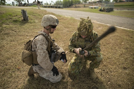 U.S. Marine Sgt. Devon L. Ward and Australian Army Pvt. Jacob Handley, combat engineers, perform a radio check at Hidden Valley Motor Sports Complex, Northern Territory, Australia, on May 19, 2016. U.S. Marine and Australian Army combat engineers conducted clearing training to find improvised explosive device and caches. Marine Rotational Force - Darwin is a six-month deployment of Marines into Darwin, Australia, where they will conduct exercises and train with the Australian Defence Forces, strengthening the U.S.-Australia alliance. Ward, from Grand Rapids, Michigan, is with 1st Combat Engineer Battalion, MRF-D. Handley, is with 1st Combat Engineer Regiment, 1st Brigade. (U.S. Marine Corps photo by Cpl. Carlos Cruz/Released)