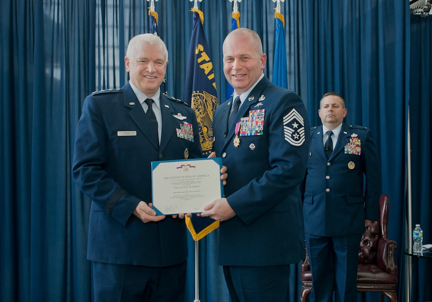 Lt. Gen. L. Scott Rice, director of the Air National Guard, presents Chief Master Sgt. James W. Hotaling, the 11th command chief master sergeant of the ANG, with the Legion of Merit during his retirement ceremony May 20, 2016, at Joint Base Andrews, Md. Hotaling retired after serving a combined 28 years in the Air Force, Air Force reserve, Air National Guard, and U.S. Coast Guard. (U.S. Air National Guard photo by Master Sgt. Marvin R. Preston/Released)
