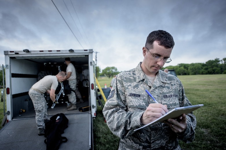 Tech. Sgt. Cory Johnson, 149th Force Support Squadron, Texas Air National Guard, headquartered at Joint Base San Antonio, takes notes during a training event at JBSA-Lackland, Texas, April 10, 2016. He is a member of the 149th FSS Fatality Search and Recovery Team.  These FSRT members are training on how to move into a contaminated area and recover remains after a chemical disaster. (U.S. Air National Guard photo by Tech. Sgt. Eric L. Wilson)