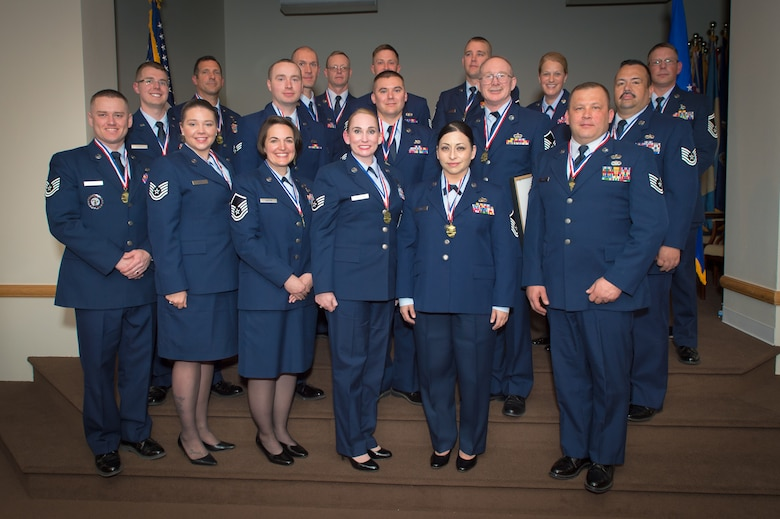 U.S. Air Force airmen with the 153rd Airlift Wing, Wyoming Air National Guard, pose for a picture, May 15, 2016 at F.E. Warren AFB in Cheyenne, Wyoming. The airmen were recognized for earning their Community College of the Air Force Associate in Science degree. (U.S Air National Guard photo by Master Sgt. Charles Delano/released)