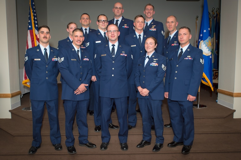 U.S. Air Force airmen with the 153rd Airlift Wing, Wyoming Air National Guard, pose for a picture, May 15, 2016 at F.E. Warren AFB in Cheyenne, Wyoming. The airmen were recognized as recent inductees at the NCO rank. (U.S Air National Guard photo by Master Sgt. Charles Delano/released)