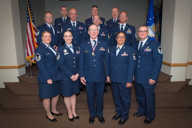 U.S. Air Force airmen with the 153rd Airlift Wing, Wyoming Air National Guard, pose for a picture, May 15, 2016 at F.E. Warren AFB in Cheyenne, Wyoming. The airmen were recognized as recent inductees at the Senior NCO rank. (U.S Air National Guard photo by Master Sgt. Charles Delano/released)