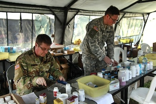 Army Maj. Lance Olsen, left, and Army Sgt. Frisco Cleary sort out medications in the pharmacy tent during Beyond the Horizon 2016 in San Padro, Guatemala, May 16, 2016. Olsen and Cleary are assigned to with the 396th Combat Support Hospital Company. Army photo by Spc. Kelson Brooks