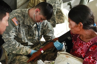 Army Spc. Joshua Towne checks a patient's blood pressure during Beyond the Horizon 2016 in San Padro, Guatemala, May 16, 2016. Towne is assigned to the 396th Combat Support Hospital Company. Army photo by Spc. Kelson Brooks