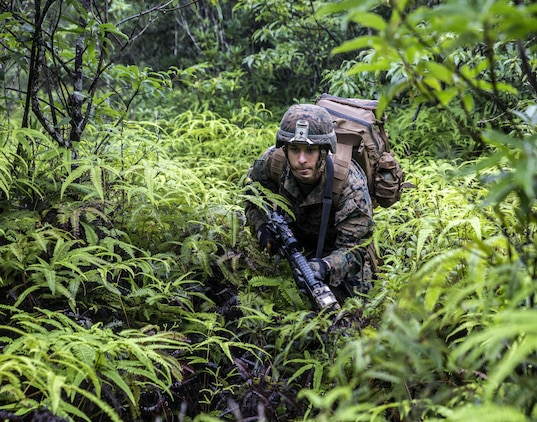 U.S. Marine Lance Cpl. Justin D. Enger runs towards the sound of simulated gun fire at the Jungle Warefare Training Center, May 19, 2016 at Camp Gonsalves, Okinawa, Japan. Enger is a combat engineer with 9th Engineer Support Battalion, 3rd Marine Logistics Group, III Marine Expeditionary Force. Enger and his platoon attended the 5-day Course at JWTC. The course gives Marines the skills to shoot, move and communicate within a jungle environment. (U.S. Marine Corps photo by Lance Cpl. Jessica N. Etheridge/Released)
