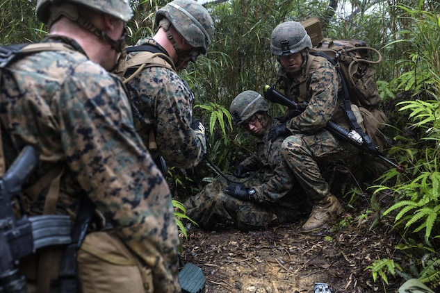 U.S. Marines practice casualty evacuations on May 19, 2016 during the 5-day course at the Jungle Warfare Training Center, Camp Gonsalvas, Okinawa, Japan. The Marines are with 9th Engineer Support Battalion, 3rd Marine Logistics Group, III Marine Expeditionary Force. The course gives Marines the skills to shoot, move and communicate within a jungle environment. (U.S. Marine Corps photo by Lance Cpl. Jessica N. Etheridge/Released)