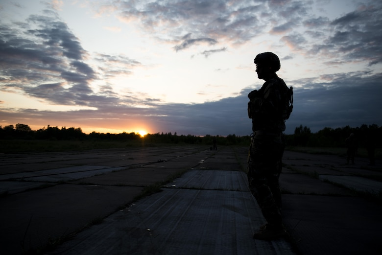 A Deployed Aircraft Ground Response Element team member assigned to the 352d Special Operations Support Squadron stands guard during a Forward Area Refueling Point training as part of TROJAN FOOTPRINT 16 in Pajuostic, Lithuania, May 15, 2016. MC-130J Commando II's, CV-22 Ospreys, MH-47 Chinook's and approximately 200 maintenance and support personnel deployed to Powidz, Poland during TF16 for joint, combined training with NATO allies. (U.S. Air Force photo by 1st Lt. Chris Sullivan/Released)