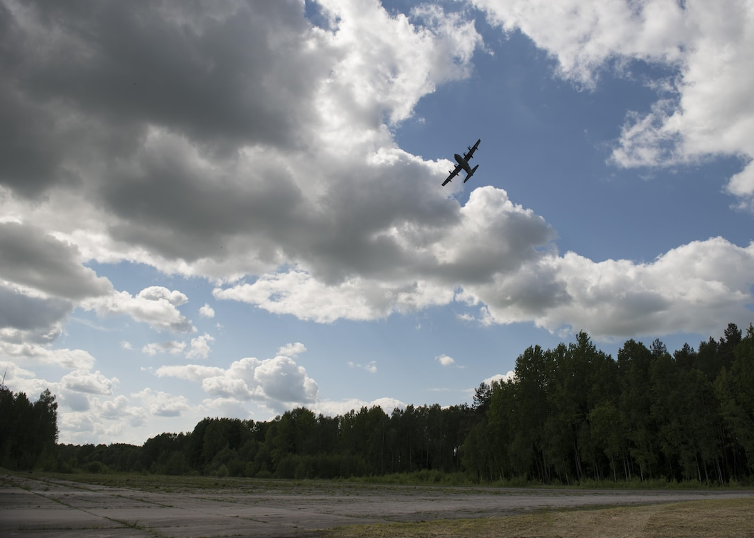 A U.S. MC-130J Commando II from the 352d Special Operations Wing, performs a low level fly-by prior to inserting heavy equipment and personnel during the joint, combined military demo for FLAMING SWORD 16 in Pajuostic, Lithuania, May 20, 2016.  The MC-130J's were deployed to Powidz, Poland as part of TROJAN FOOTPRINT 16 which rapidly deployed more than 800 Special Operations Forces personnel from NATO and partner nations across the exercise's training areas to ensure the Alliance and partner nations are able to rapidly assemble and train anywhere they are called to do so. (U.S. Air Force photo by 1st Lt. Chris Sullivan/Released)