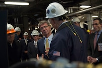 Defense Secretary Ash Carter speaks with an employee during a tour of an electric  boat facility in Groton, Conn., May 24, 2016. DoD photo by Air Force Senior Master Sgt. Adrian Cadiz