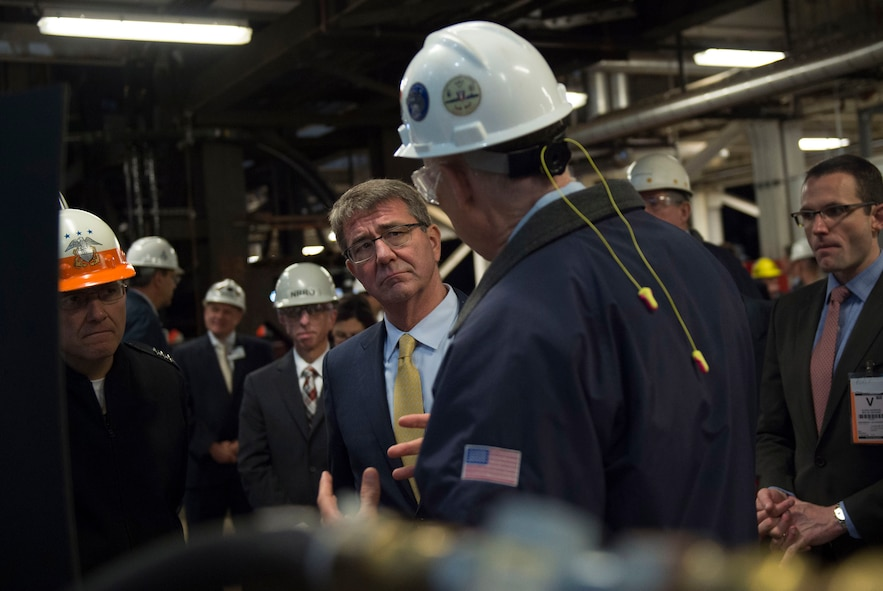 Defense Secretary Ash Carter speaking with an employee.