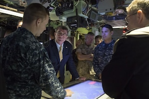 Defense Secretary Ash Carter receives a briefing on the capabilities of the USS New Mexico as he tours the submarine during a visit to Naval Submarine Base New London, Conn., May 24, 2016. DoD photo by Air Force Senior Master Sgt. Adrian Cadiz