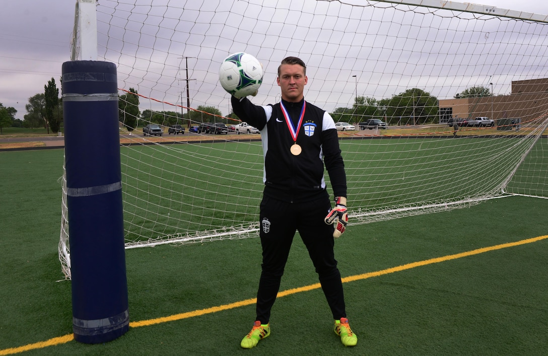 Senior Airman Kerry Segebart, 27th Special Operations Medical Support Squadron unit deployment manager, stands in his team uniform wearing a gold medal that came with a victory over the All-Armed Forces Championship tournament last month, May 19, 2016, at Cannon Air Force Base, N.M. Segebart attended an invitational soccer camp to make the Air Force team this past April, and was among the 18 selected for the team. (U.S. Air Force photo/Staff Sgt. Alexx Pons)